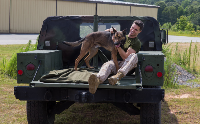 Max and his handler US Marine Kyle Wincott Photo courtesy of Warner Bros. Pictures